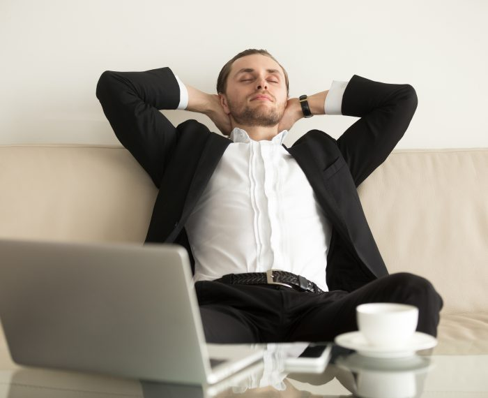 Man relaxing after completing an important work